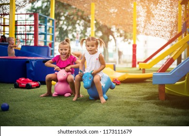 We are happy kids. Two little friend playing together on playground.