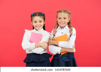 We have all the best stories. Little girls holding books of english literature. Small children enjoying childrens literature. Literature education. Literature lessons at school.