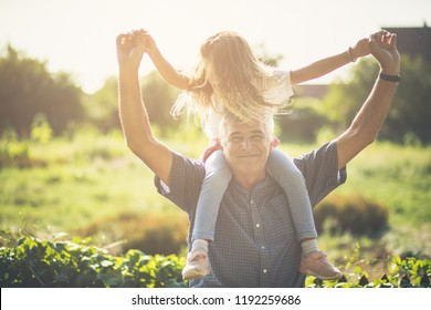 We have day for fun. Grandfather and granddaughter spending time together in nature. Copy space.