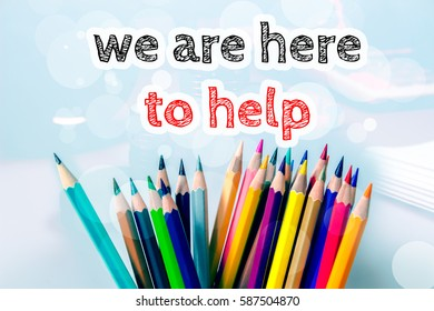 We are here to help, text message on blue background with color pencil