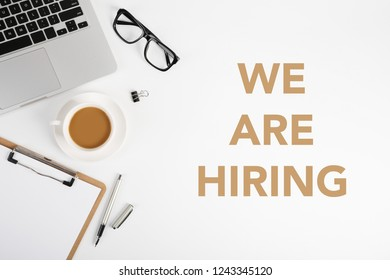 We are hiring concept on the office desktop.