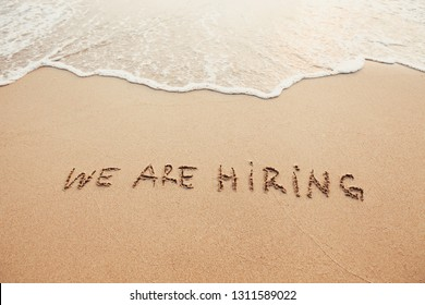 we are hiring, concept on sand
