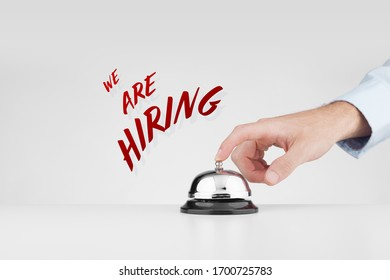 We are hiring marketing concept. Headhunter (recruiter, human resources staff) beats alarm (press ring bell) to point out job offer.