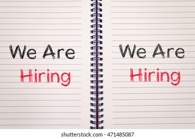 We are hiring news text concept write on notebook