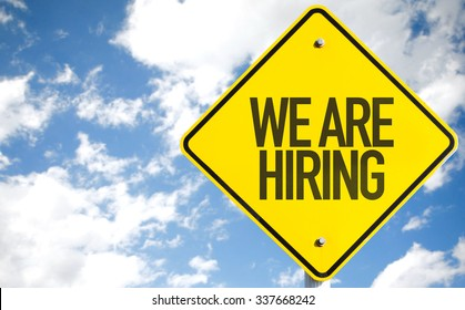 We Are Hiring sign with sky background