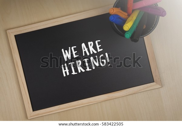 We Are Hiring! words writing on chalkboard.