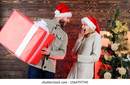 We love each other. couple in love santa hat. Holiday presents. family christmas party. winter season sales. greeting time. Huge surprise. happy new year. Santa gift delivery. woman and man love xmas.