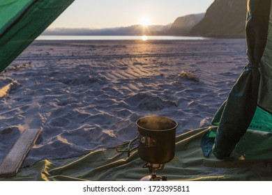 we make coffee on a stove in the tent while watching the sunset over the sea