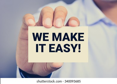WE MAKE IT EASY! message on the card shown by a man, vintage tone
