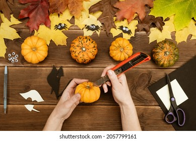 We make gifts for Halloween. Making a funny bat out of a small yellow pumpkin. Halloween party decor. DIY instruction. Step by step guide. Step 5.