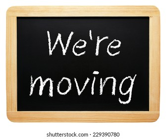 We are moving - chalkboard on white background