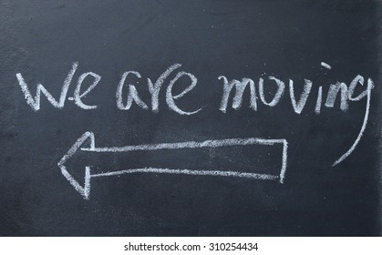 we are moving sign on blackboard