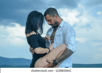 We need to live with passion. Passionate couple concept. Vibrant with passion. A passion for latin man body. Sensual couple on sky background