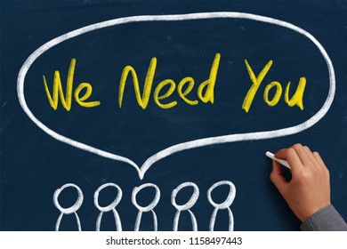 We Need You concept on the chalkboard with writing hand.