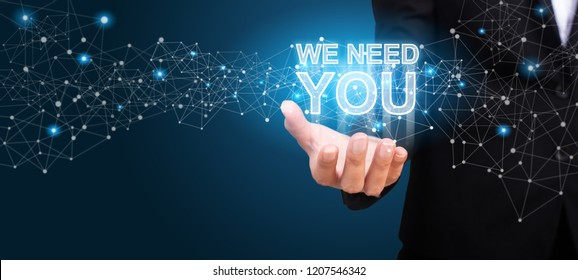 WE NEED YOU in the hand of business. We Need You concept.