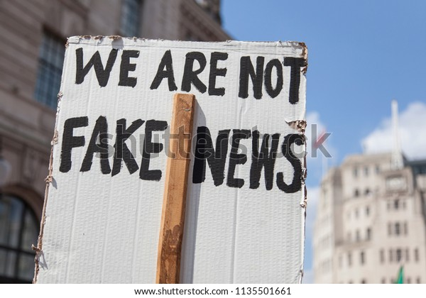 We are not fake news political banner at a protest march