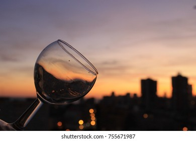 We observe in romantic sunset through the glass cup. Enigmatic sunset in shades of yellow, orange and fire red.