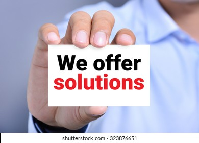 We offer solutions, message on the card shown by a man
