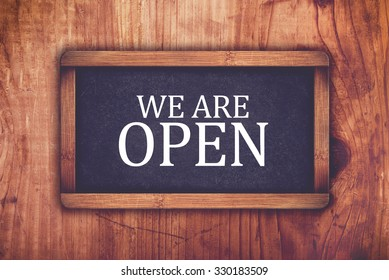 We are open shop message board, retro toned chalkboard rustic oak wood store opening hours door