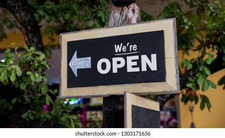 We are Open Written on a Wooden Sign board