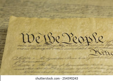We the People are the opening words of the preamble to the Constitution of the United States of America. Shallow depth of field.