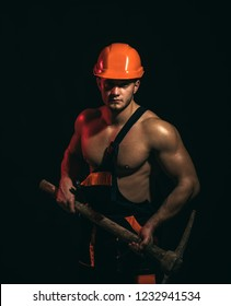 We renovating, under construction. Construction worker. Muscular man worker. Hard worker with muscular torso. Man miner with mining equipment. Mining area under construction.