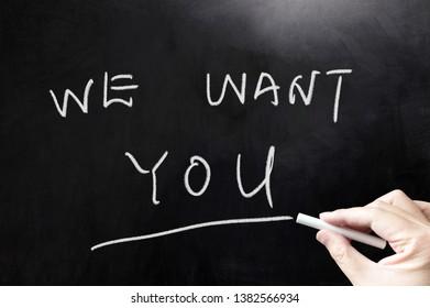 We want you concept words written on blackboard