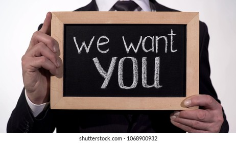 We want you phrase on blackboard in businessman hands, promising job offer, stock footage