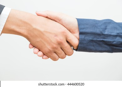 We were join venture, Hand shake between a businessman and a businesswoman in suit on white background