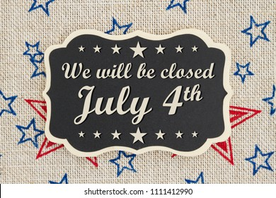 We will be closed July 4th text for Independence Day on a chalkboard with patriotic USA red and blue stars on burlap