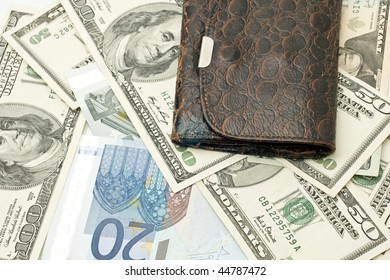 Wealth - old wallet, US dollars and euro banknotes