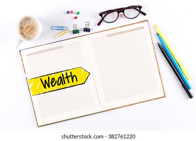 Wealth text on notebook with copy space
