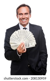 Wealthy and successful. Waist up of confident mature man in formalwear holding money and smiling while standing against white background