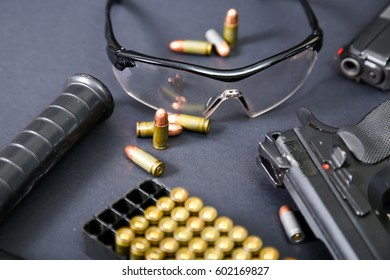 Weapon with ammunition on a black background