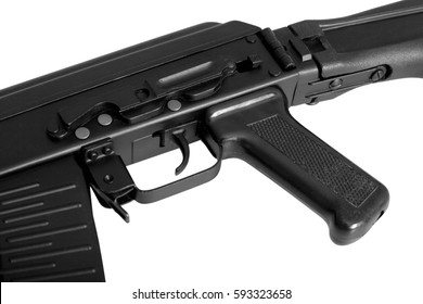 Weapon - A close up black Assault rifle on a white background. It is isolated, the worker of paths is present.