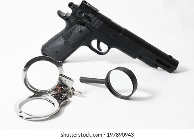 Weapon Crime Concept Gun and Handcuffs on a White Background
