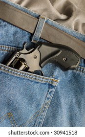 weapon in pocket jeans gunman