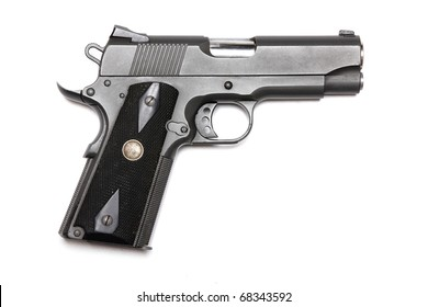 """Weapon series. 1911-family handgun with 4.3"""" barrel. Isolated on a white background. Left side view. Studio shot."""