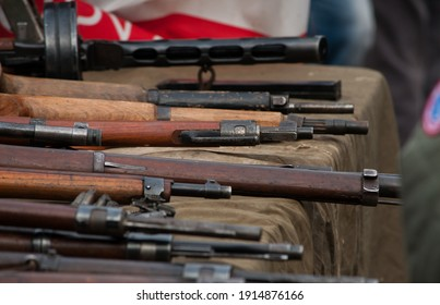 weapons laid out on the table Arms trafficking. different rifles on the counter in the gun shop. clandestine sale of weapons. illegal purchase of weapons. firearms on the table. illegal deal to sell w