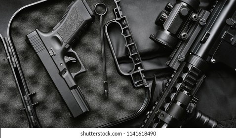Weapons and military equipment for army, Assault rifle gun (M4A1) and handgun 9mm on black background.