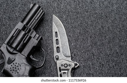 weapons on a dark background