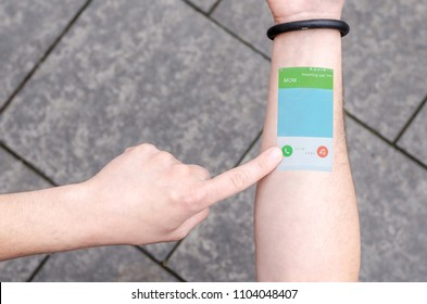Wearable Projection Bracelet Smartphone Mobile Phone on Man Hand Invisible Tech technology Innovations Future Concept Bussines. Technological Progress Communication. Incoming call.