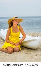 Nude girl straw hat kneeling boat