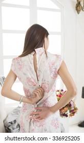 Wearing cheongsam Chinese woman.Beautiful sexy back
