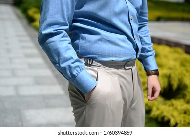wearing elegant clothes - shirt and trausers tailor made