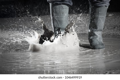 wearing waterproof boots in a rainy day
