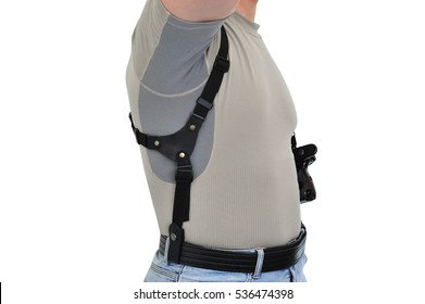 The wearing of weapons: a man's torso with a shoulder holster for gun and firearm, close-up - half-face