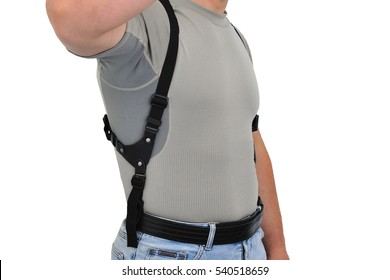 The wearing of weapons: a man's torso with a shoulder holster and gun, close-up