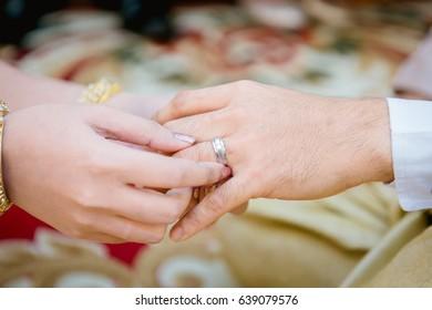wearing wedding ring ceremony