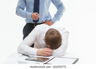 Weary clerk sitting at the table and his dissatisfied boss standing behind , white background